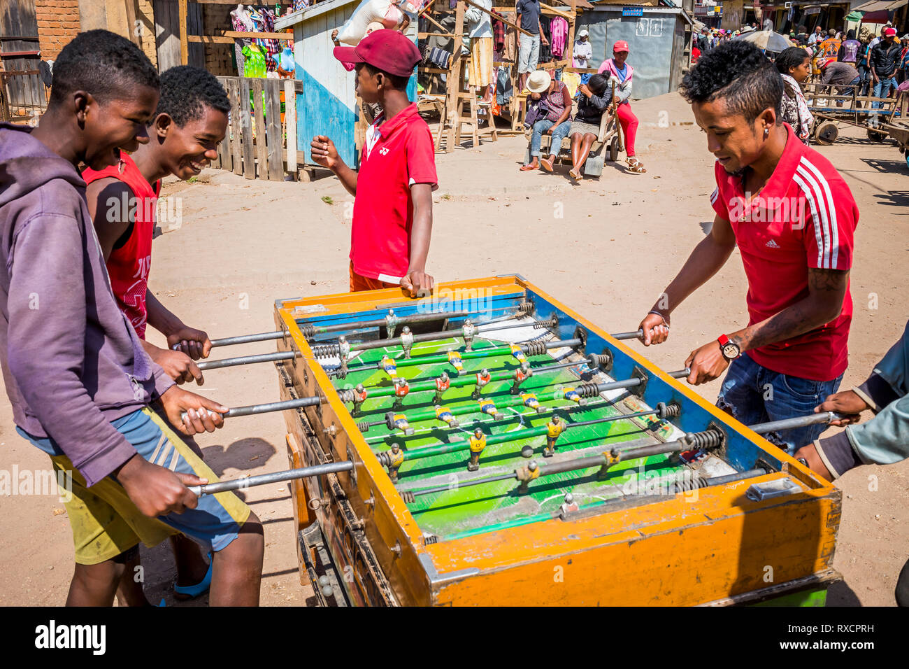 Playing table football, Ambohimahasoa city, Madagascar - Stock Image