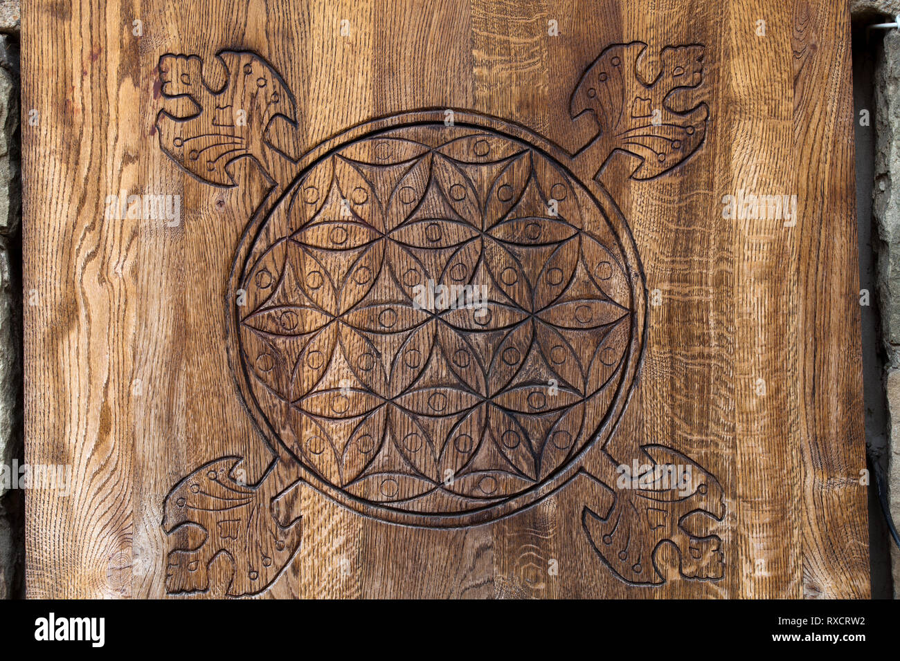Wooden Flower of Life.  The Flower of life is an ancient symbol of Sacred Geometry and represents the fundamental order of creation. - Stock Image