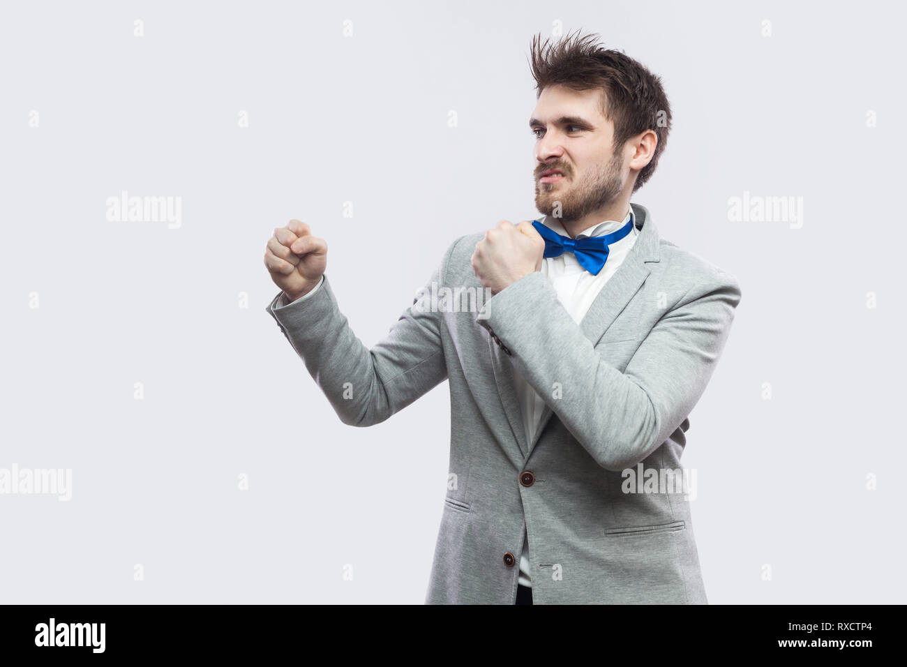 420b009287f3 Profile side view portrait of serious handsome bearded man in casual grey  suit and blue bow