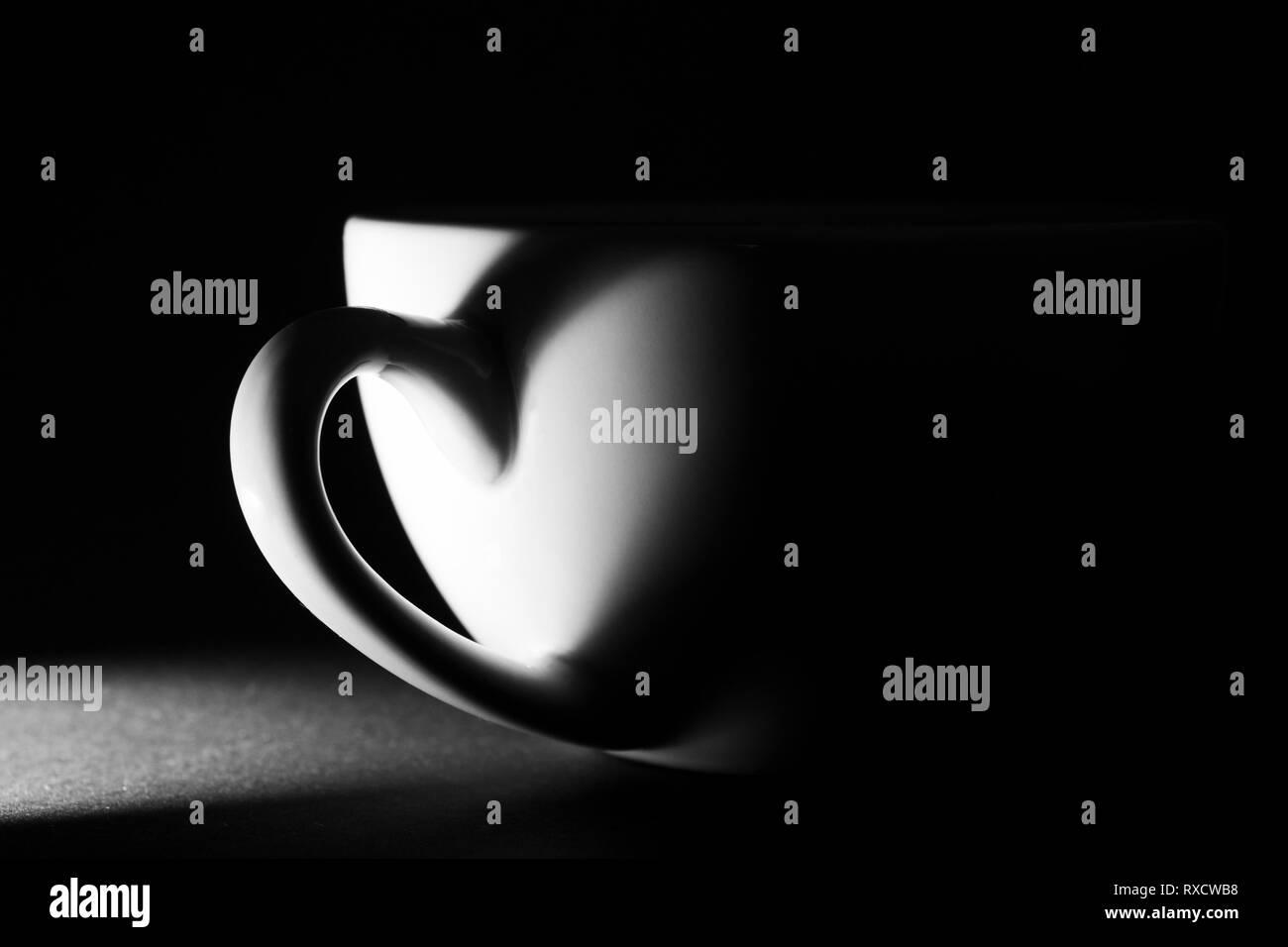 Tasse Licht & Schatten und ein Herz - Stock Image