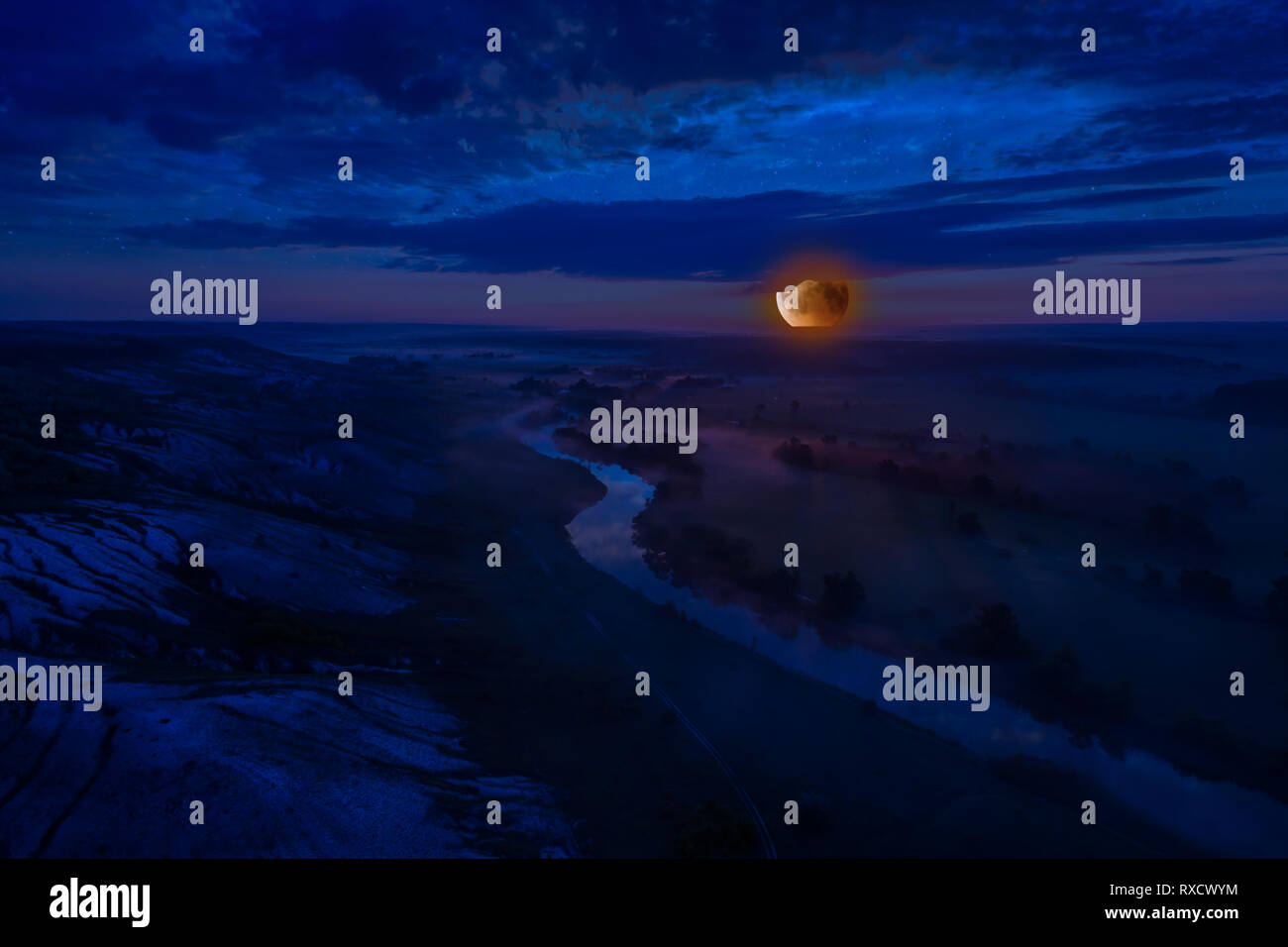 Landscape with bloody moon rise, river and night fog, make from drone, aerial view - Stock Image