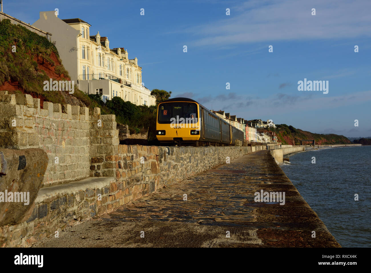 A GWR local train heading for Paignton, arriving at Dawlish. - Stock Image