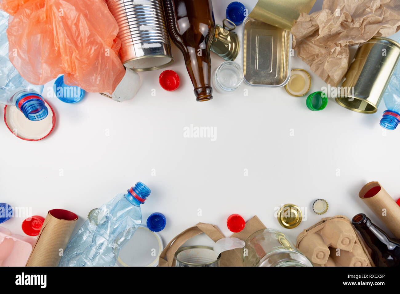 Plastic, glass, metal and paper garbage for recycling concept reuse and recycle. Copy space - Stock Image