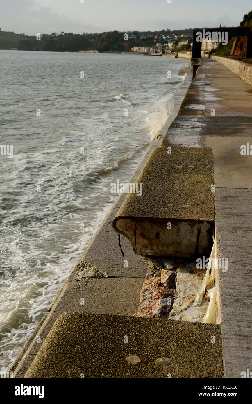 A missing section of the sea wall at Dawlish. - Stock Image