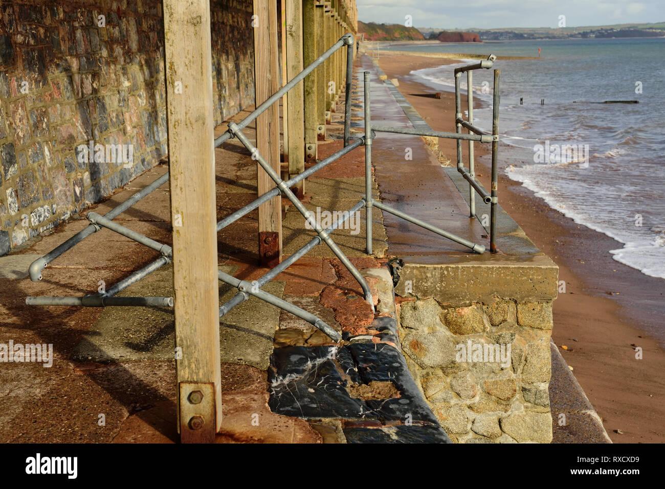 Damaged railings along the sea wall at Dawlish. - Stock Image