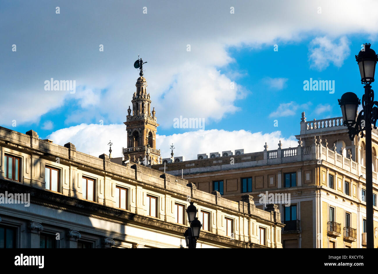 She who turns, the weather vane on top of La Giralda bell tower in Seville - Stock Image