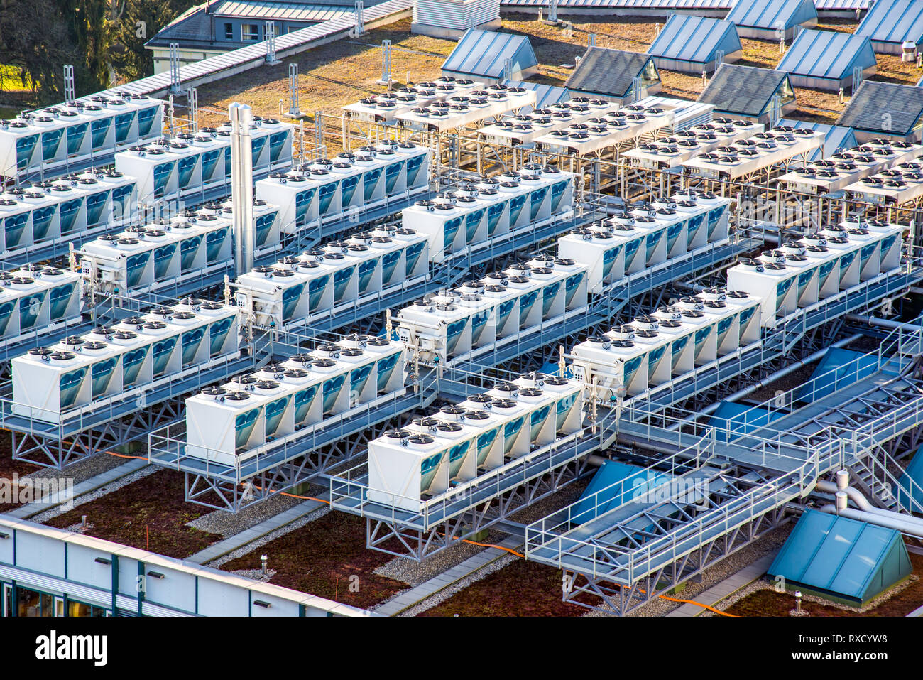 Air conditioner units on a roof of industrial building - Stock Image