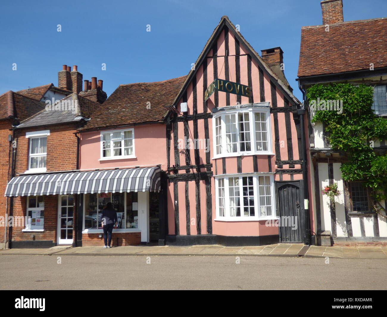 Bakery in the historic Tudor half-timbered buildings in Lavenham, Suffolk, UK. Sunny day. - Stock Image