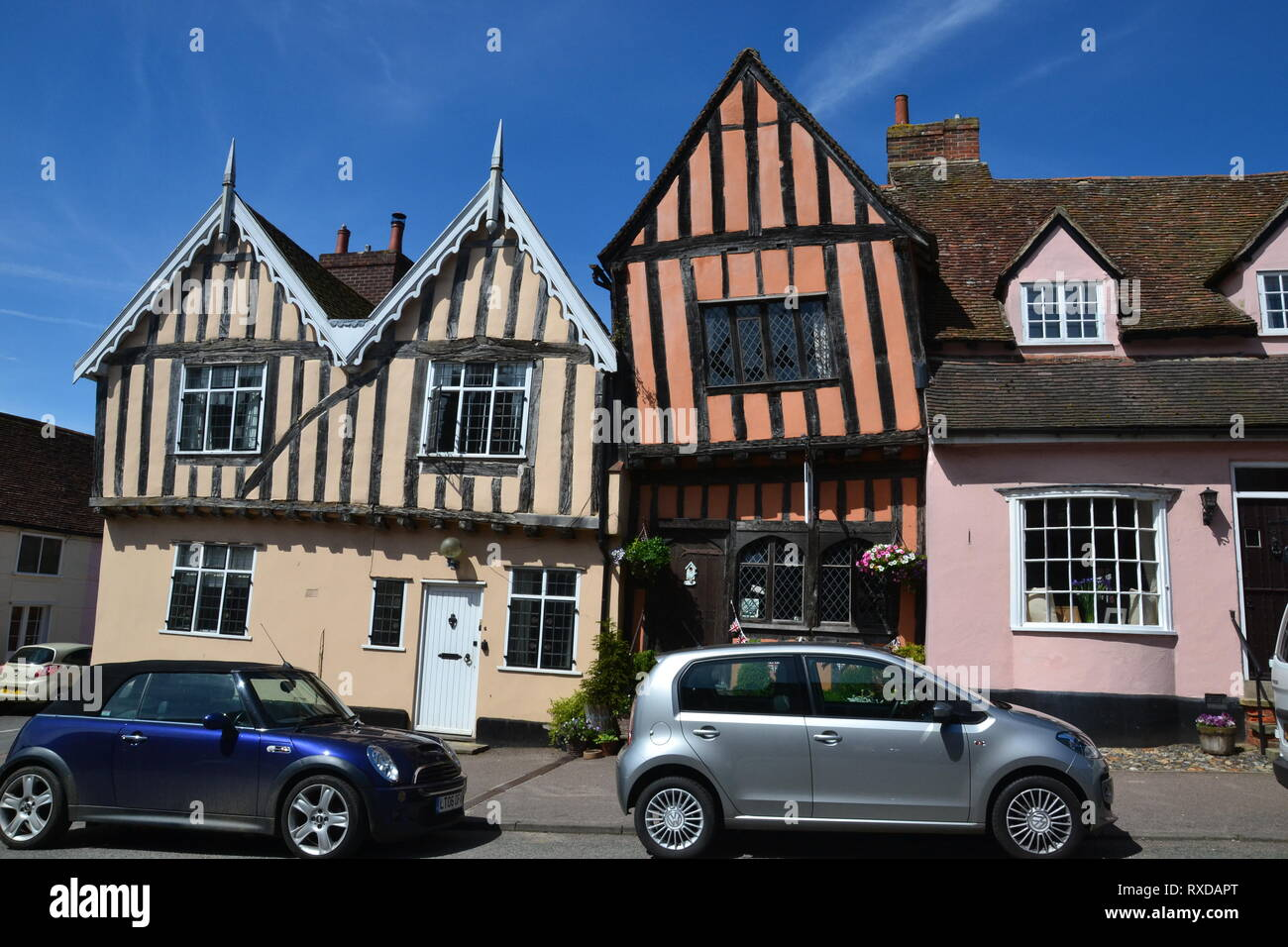 Historic Tudor half-timbered buildings in Lavenham high Street, Suffolk, UK. Sunny day. - Stock Image