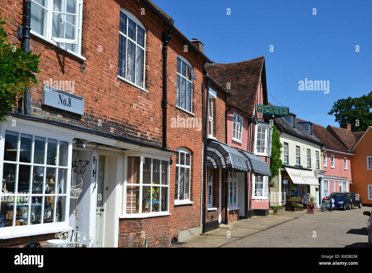 Historic shops and other buildings in Lavenham, Suffolk, UK. Sunny day. - Stock Image