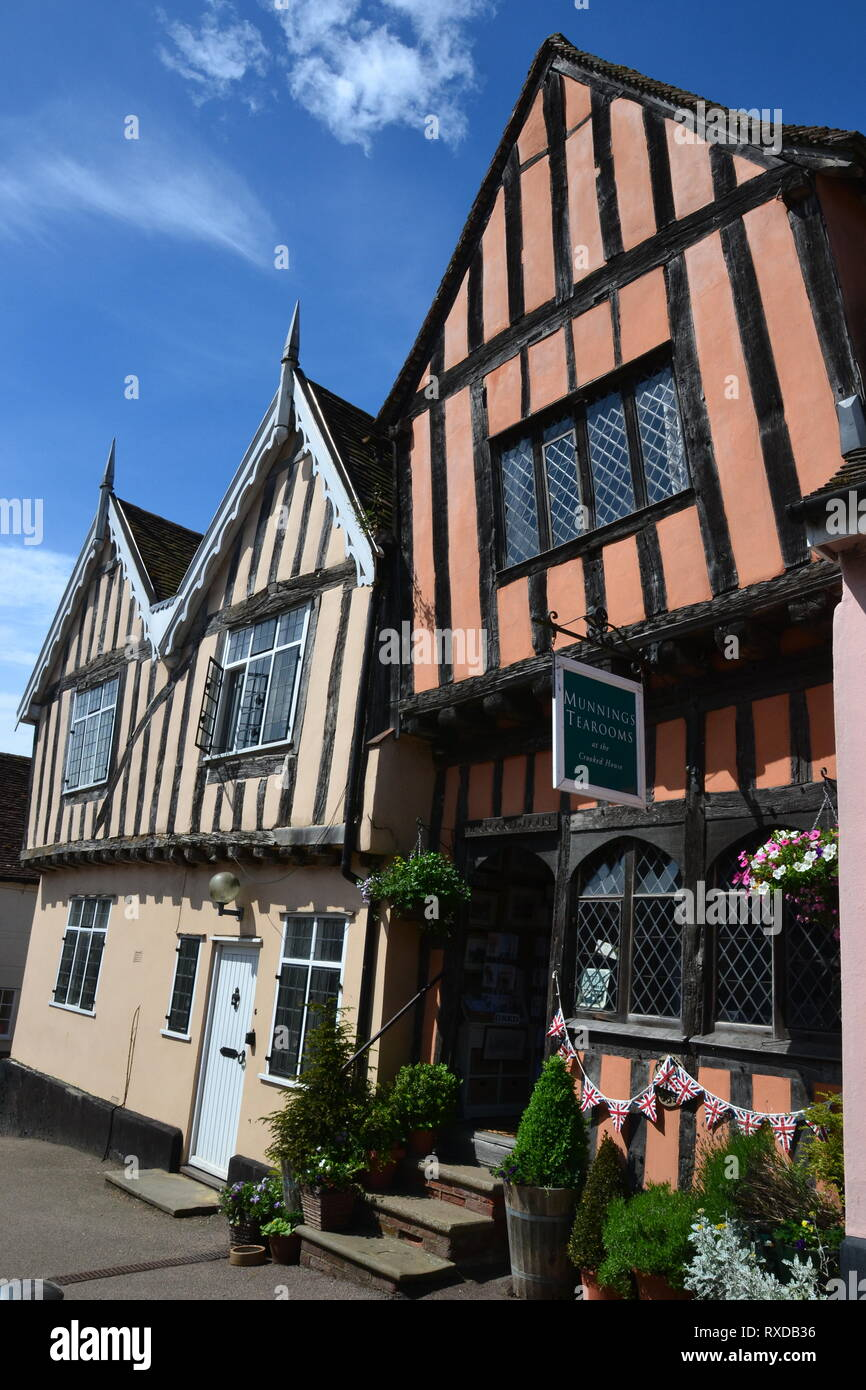 Historic Tudor half-timbered buildings and shops in the High Street Lavenham, Suffolk, UK. Sunny day. - Stock Image
