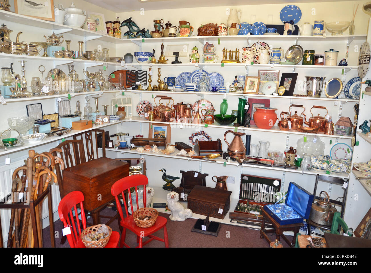 Inside an antique and curiosities shop in Lavenham, Suffolk, UK. Sunny day. - Stock Image