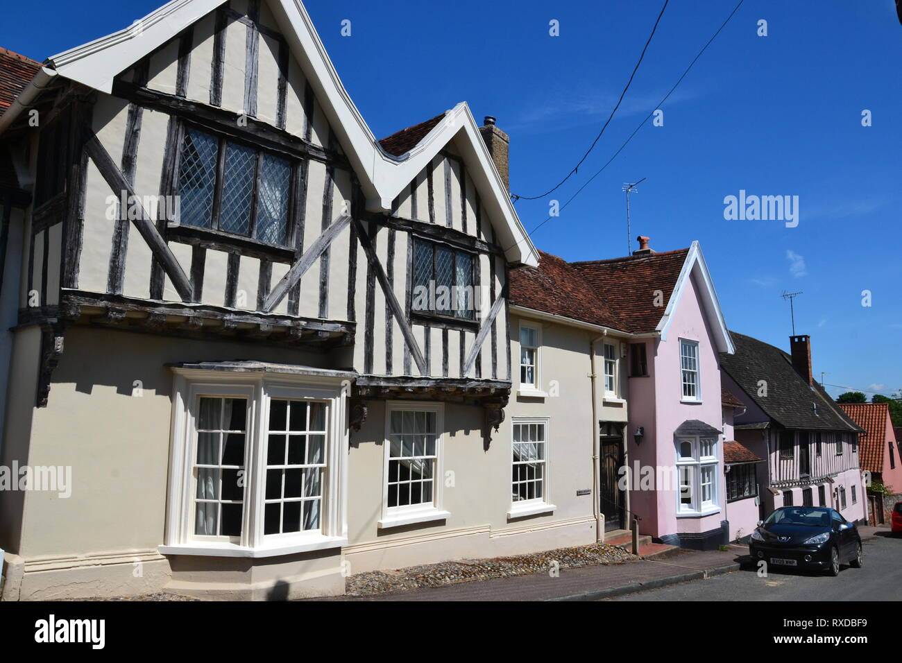 Historic Tudor half-timbered buildings in Lavenham, Suffolk, UK. Sunny day. - Stock Image
