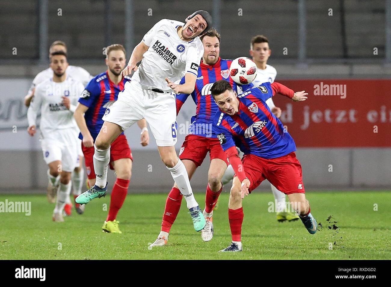 firo: 08.03.2019 Football, 3. Bundesliga, season 2018/2019 KFC Uerdingen 05 - Karlsruher SC Maurice Litka (# 8, KFC Uerdingen 05) in duels with Damian Rovubach (# 6, Karlsruher SC) | usage worldwide - Stock Image