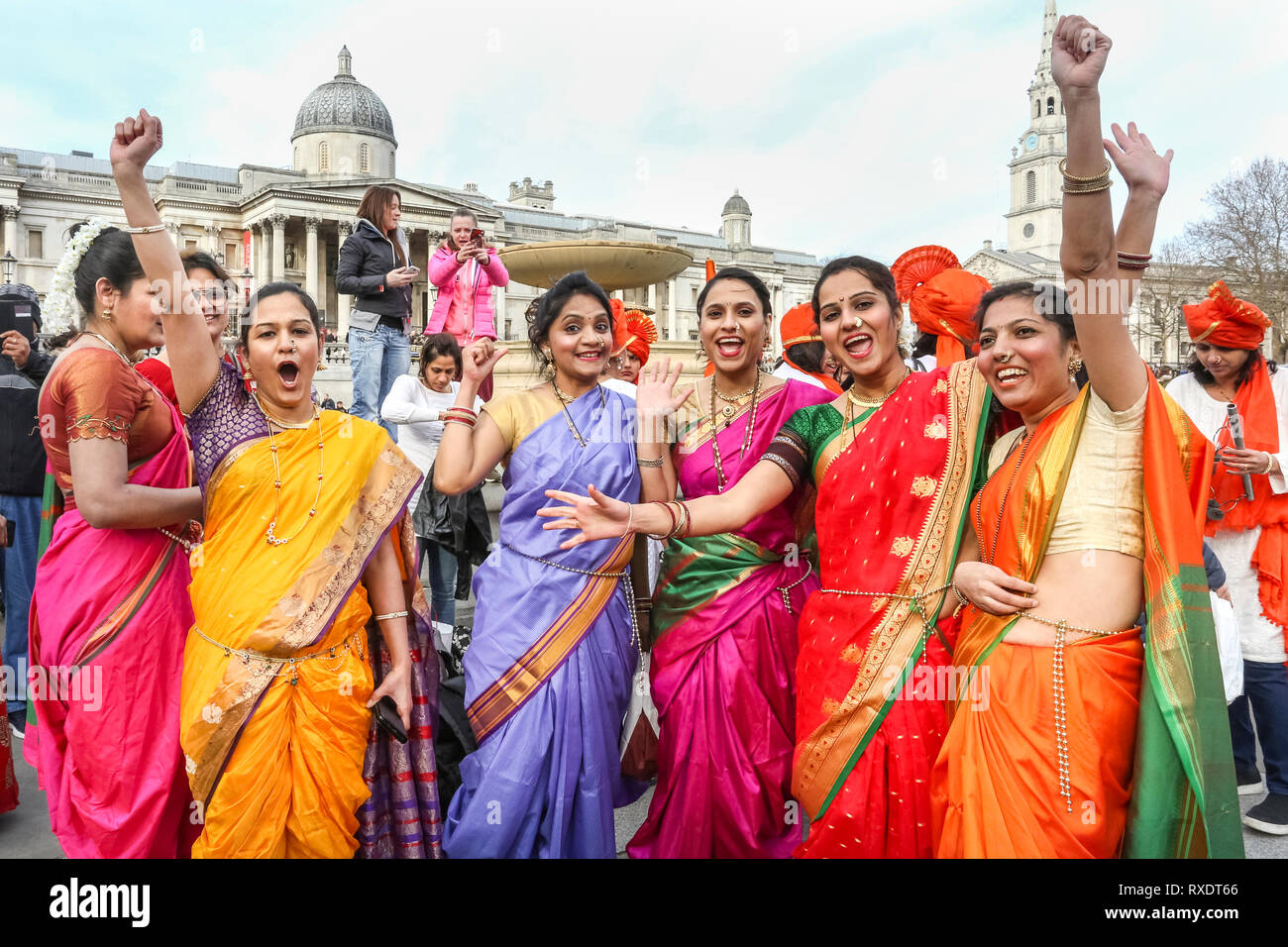 London, UK. 9th Mar, 2019. PAn Indian Dance Group proudly joins in with the march. rotesting women arrive in Trafalgar Square for the event speeches. Thousands of Women march through Central London from Oxford Street to Trafalgar Square to protest for an end to violence against women, for freedom and justice in the annual Million Women Rise event. The theme this year is 'Never Forgotten'. Credit: Imageplotter/Alamy Live News Credit: Imageplotter/Alamy Live News - Stock Image