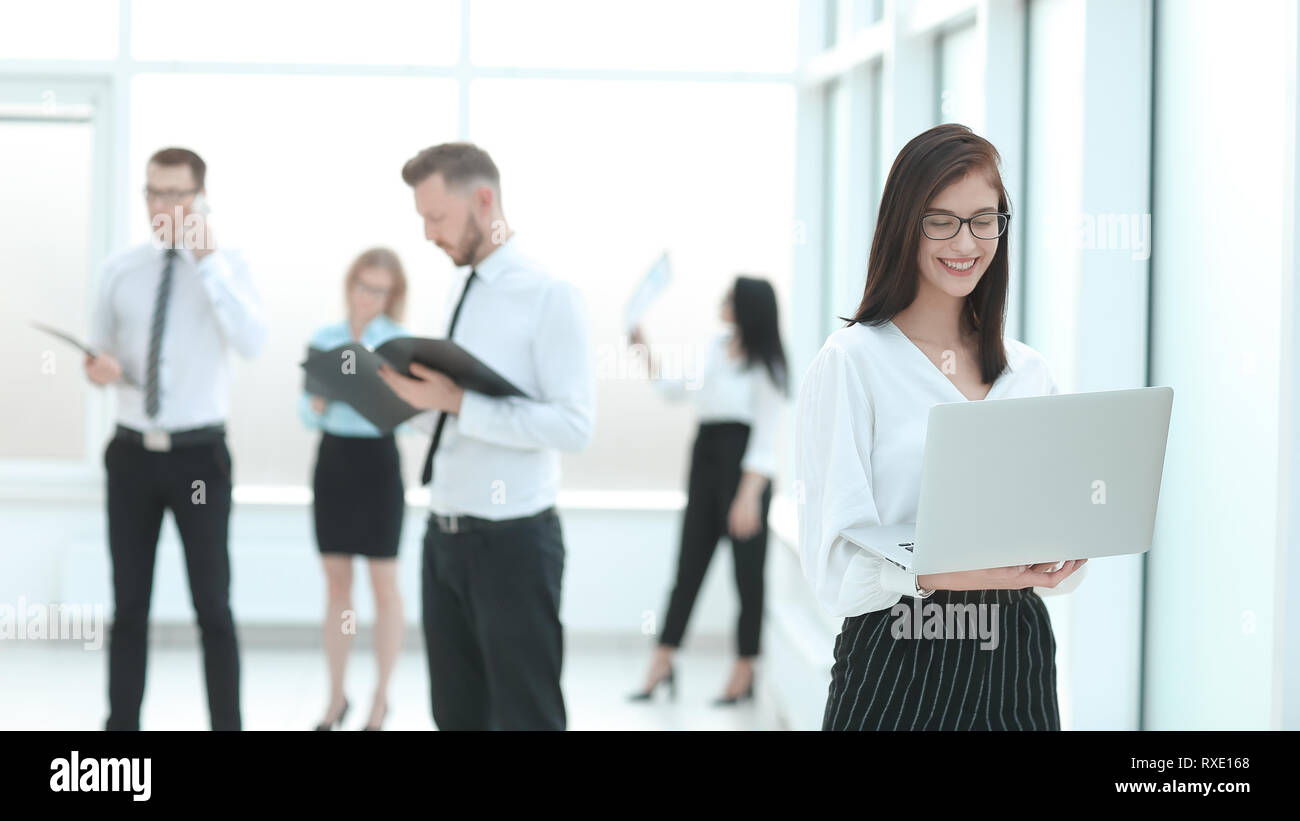 employees standing in the office lobby before a business meeting. - Stock Image