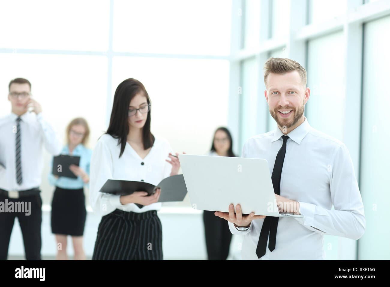 professional business team standing in the office lobby - Stock Image
