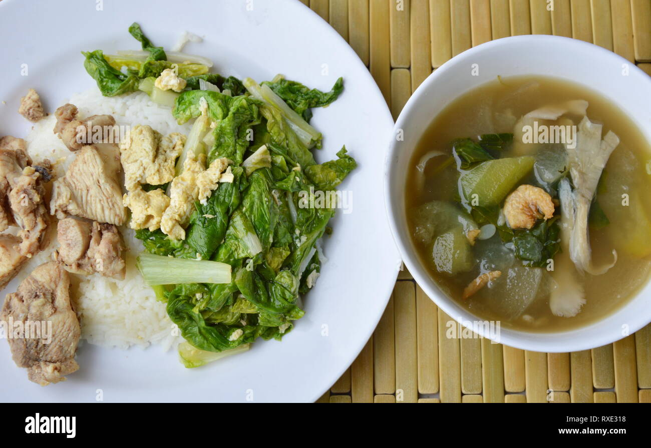 stir fried Chinese cabbage and salty chicken on rice eat with mixed vegetable soup - Stock Image
