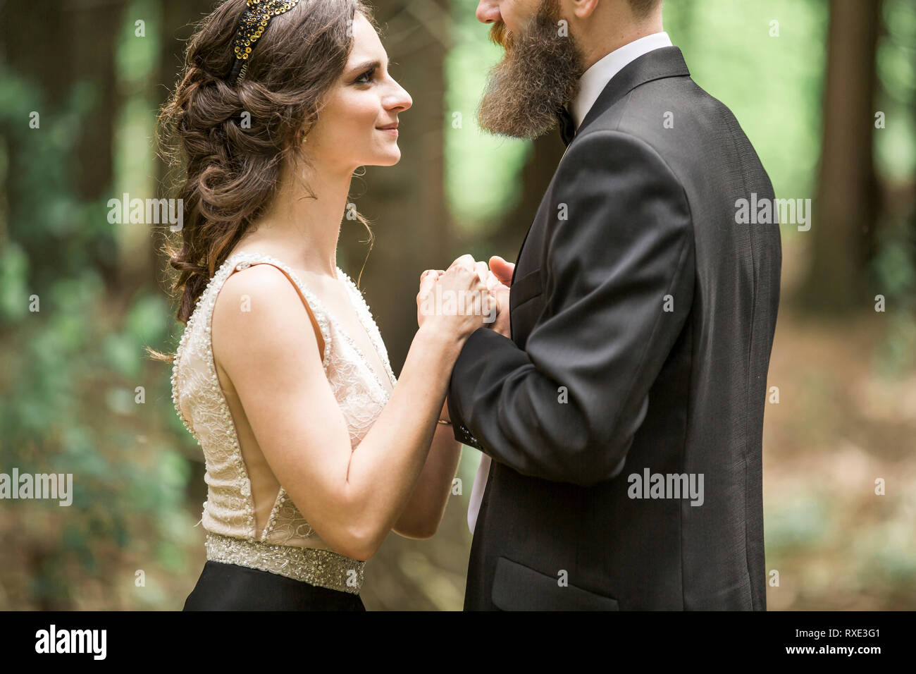portrait of loving couple on nature background - Stock Image