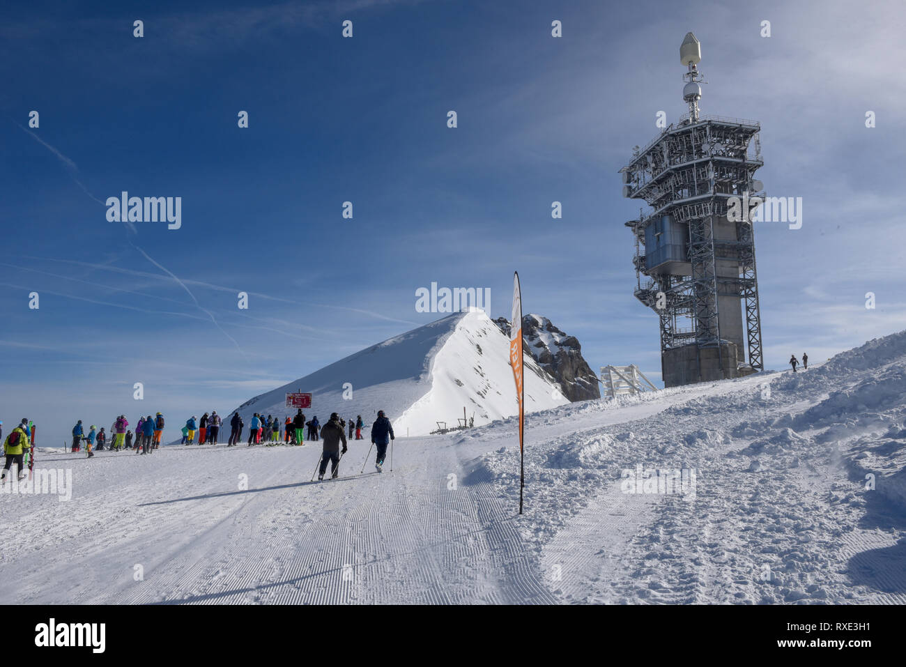 Engelberg, Switzerland - 3 March 2019: people getting ready to go skiing on mount Titlis over Engelberg in the Swiss alps Stock Photo