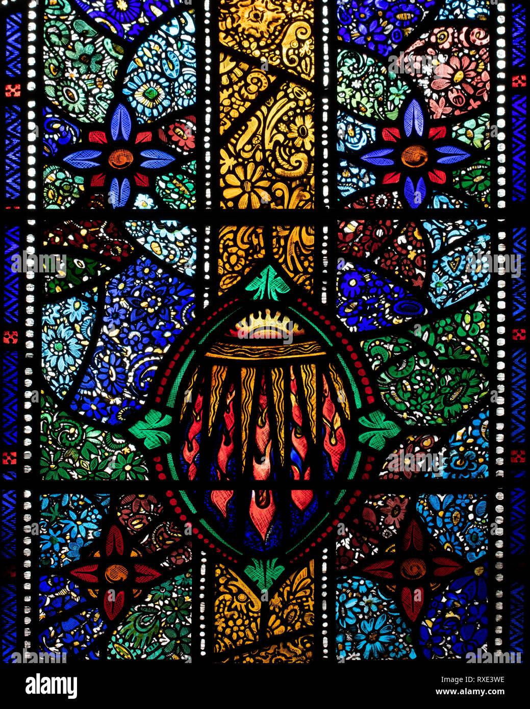 Part of the joyful 'Pentecost' millenium window in St. Oswald & St. Edmund Church, Ashton-in-Makerfield, Greater Manchester, UK - Stock Image