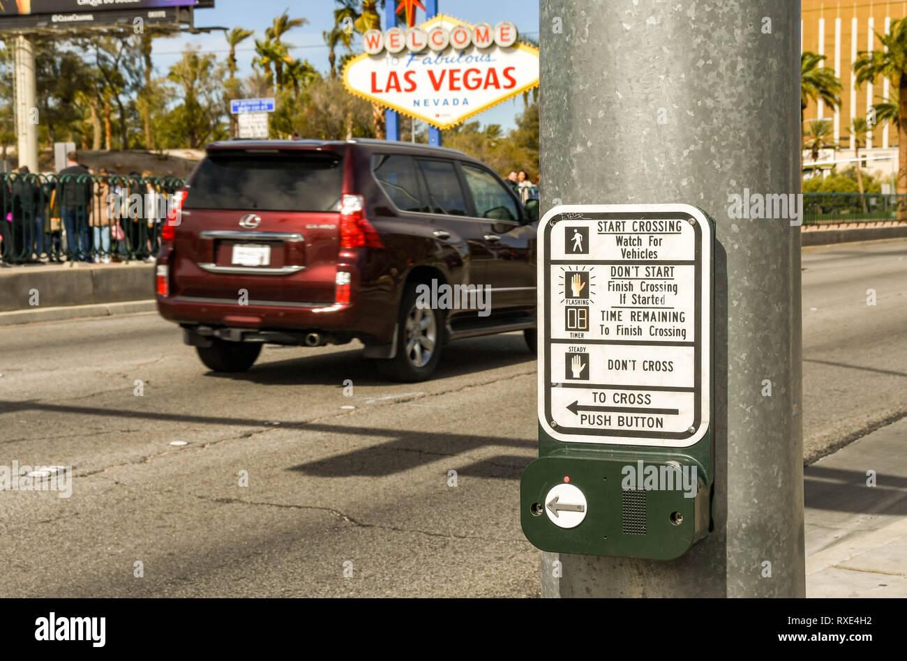 LAS VEGAS, NV, USA - FEBRUARY 2019: Push button operating panel for a pedestrian road crossing on Las Vegas Boulevard. - Stock Image