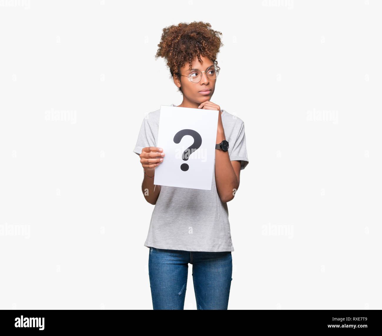 Young african american woman holding paper with question mark over isolated background serious face thinking about question, very confused idea - Stock Image