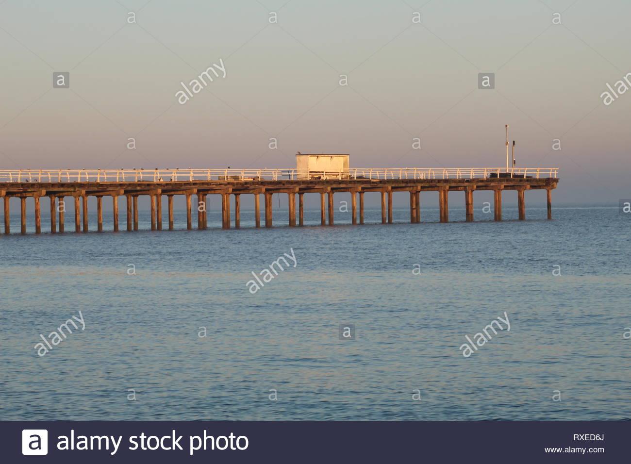 Wood Pier in England at sundown - Stock Image