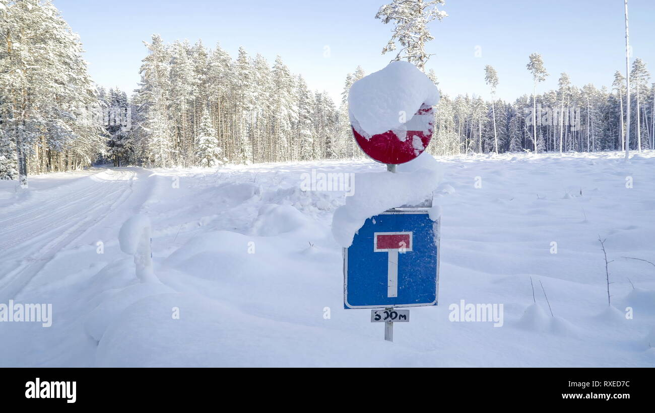 The street sign covered with thick snow on a winter season. The thick snow covering the street in Estonia - Stock Image
