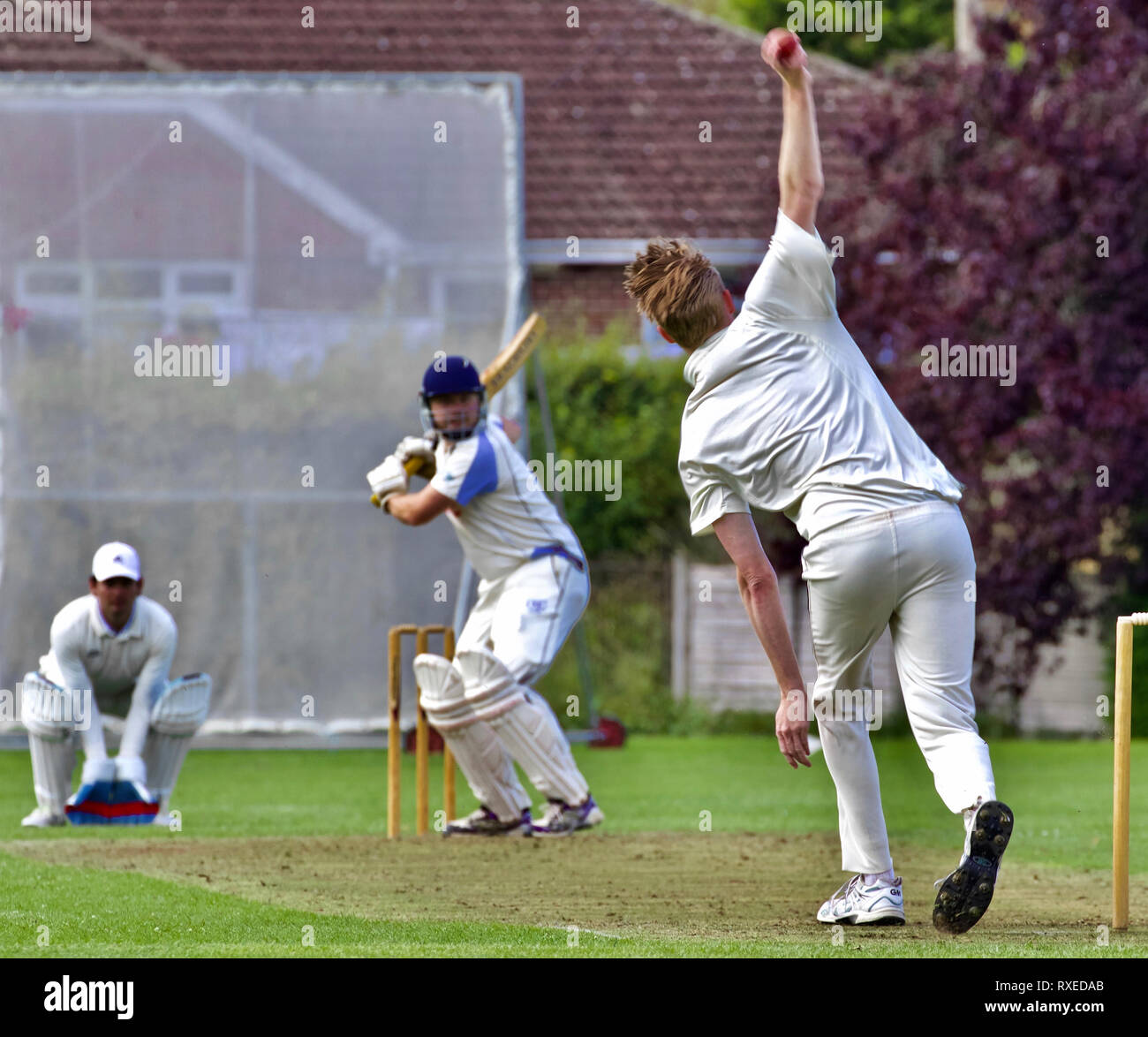 Bowler, batsman and wicket keeper - Stock Image
