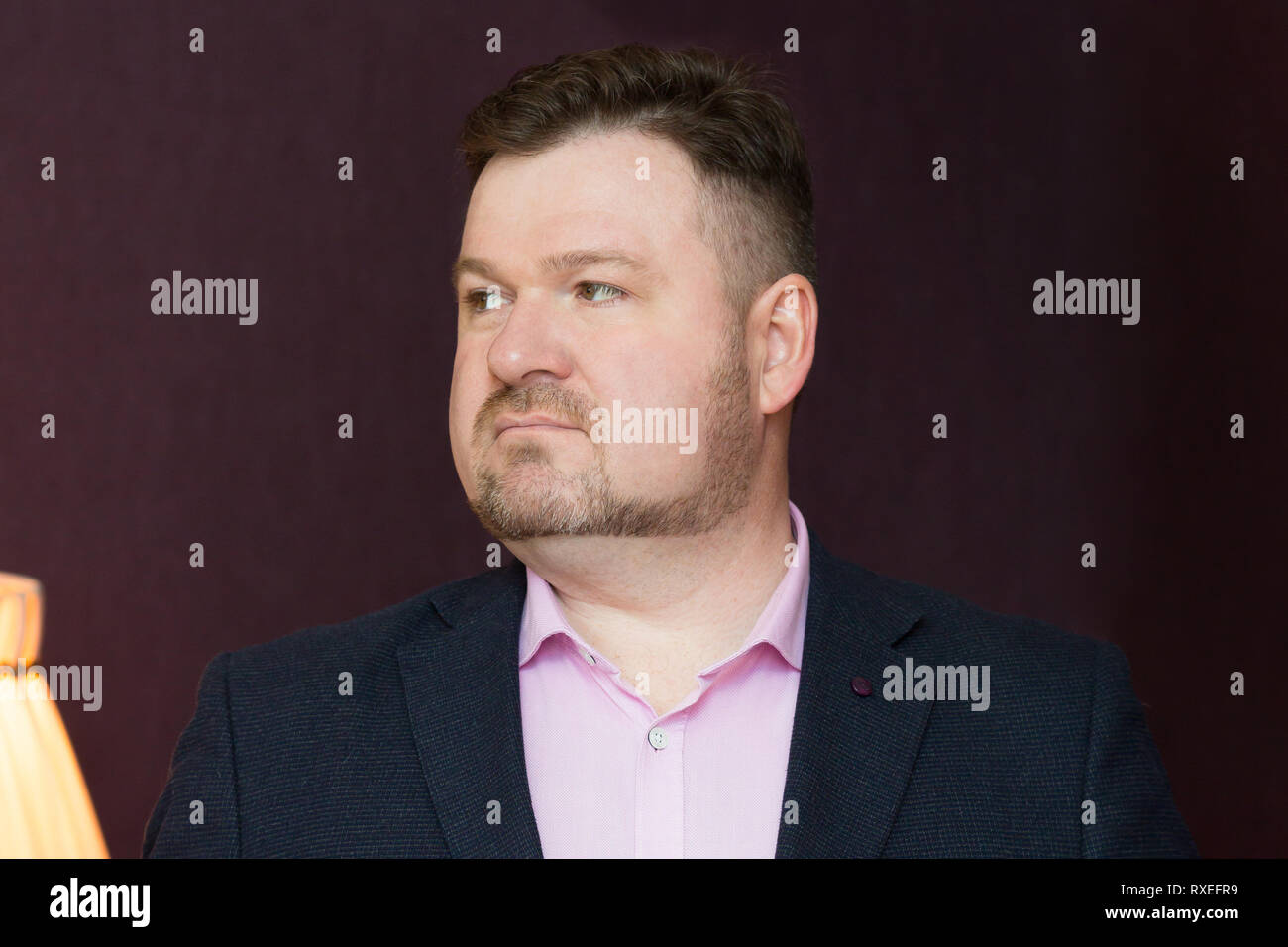 Male 45 years old with obesity on a dark background. - Stock Image