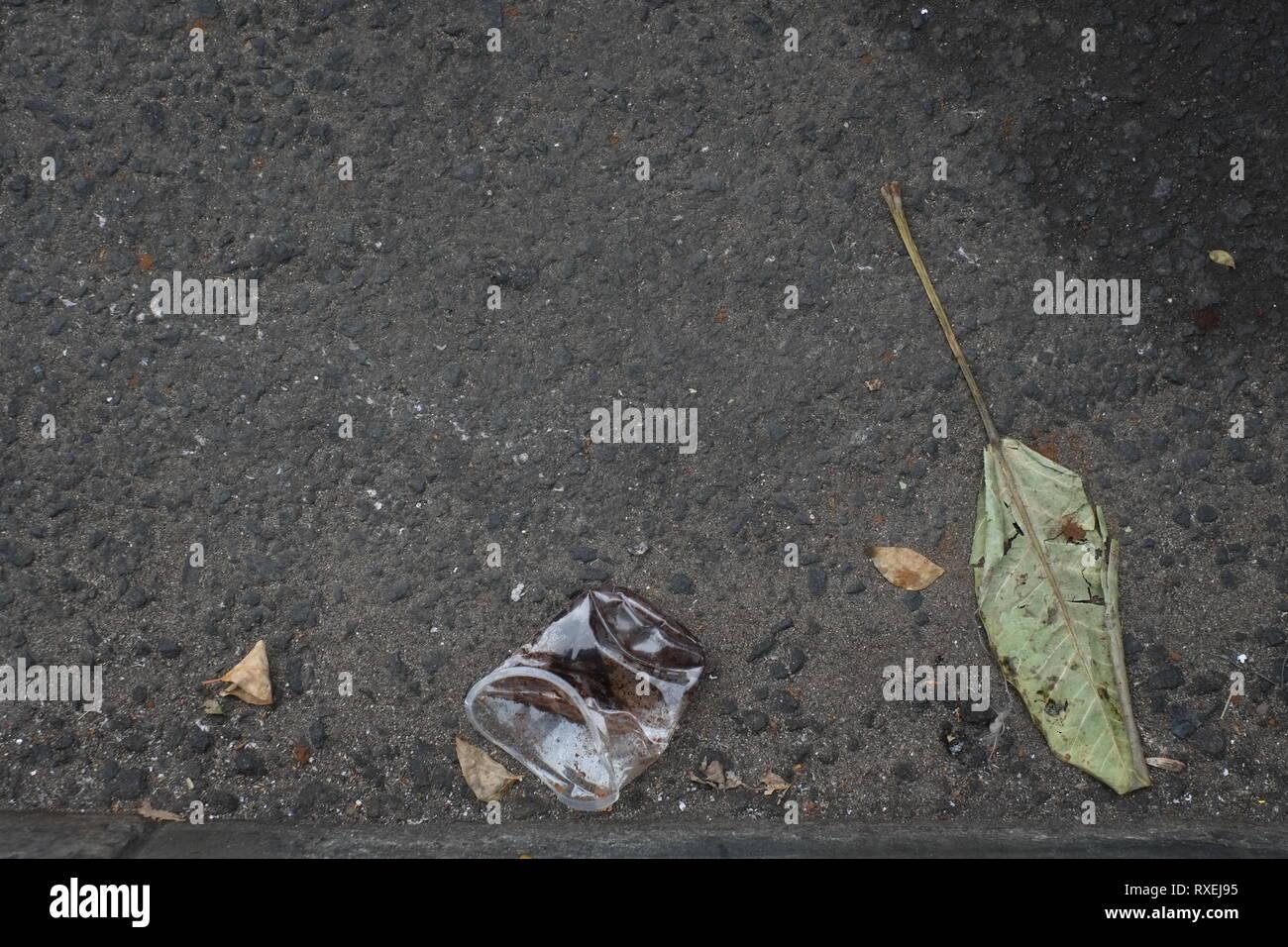 Plastic waste on streets. - Stock Image