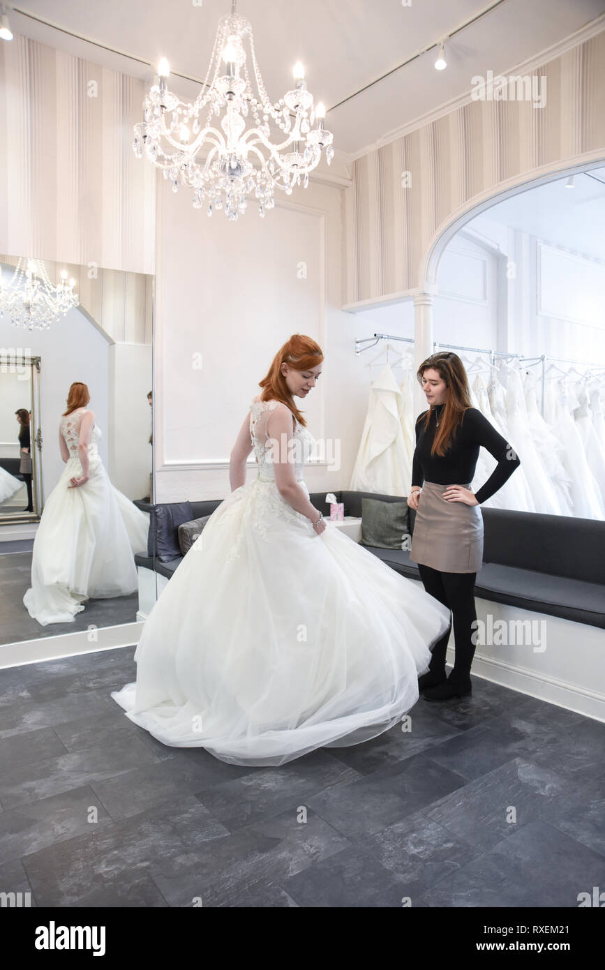 Pretty Caucasian Girl Trying On Wedding Dresses In An