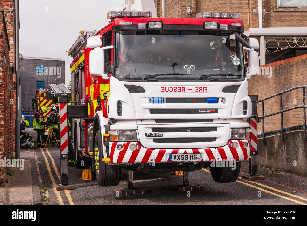 Cleveland Fire and Rescue staff using a Simon Snorkle ladder on a training exercise at high rise flat at Stockton-on-Tees, UK - Stock Image