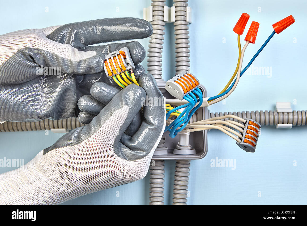 Brilliant Electrician In Protective Gloves Is Installing Surface Mounted Wiring 101 Tzicihahutechinfo