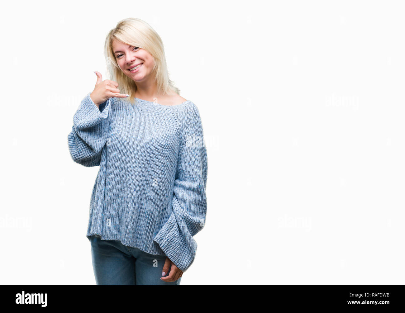 Young beautiful blonde woman wearing winter sweater over isolated background smiling doing phone gesture with hand and fingers like talking on the tel - Stock Image