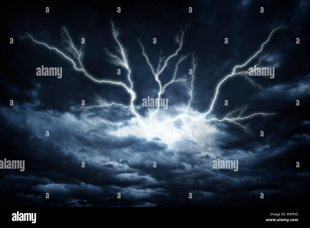 Lightning strike on the dark cloudy sky. Stock Photo