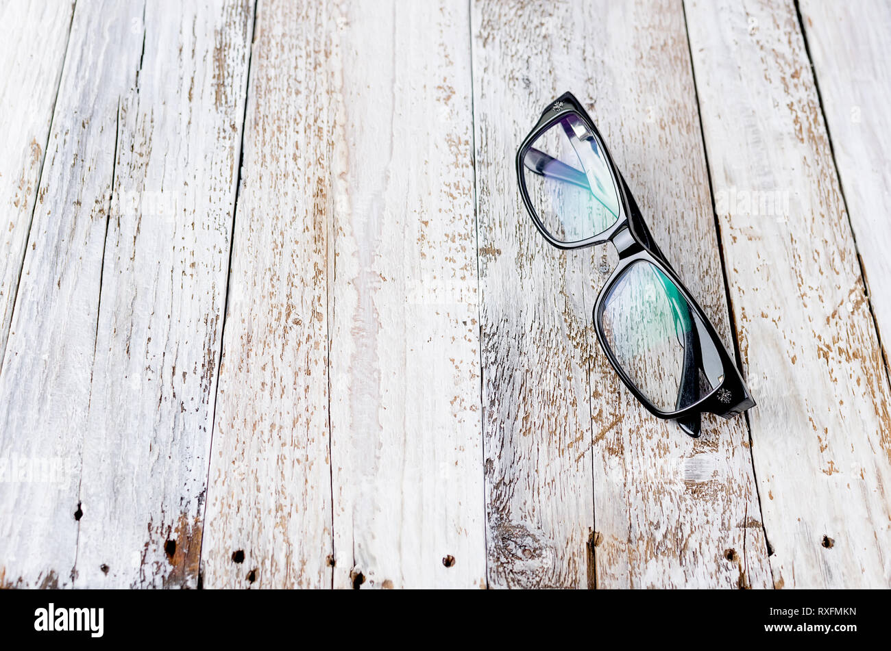 Black glasses on white wooden background. Flat lay, top view, mockup, copy space - Stock Image