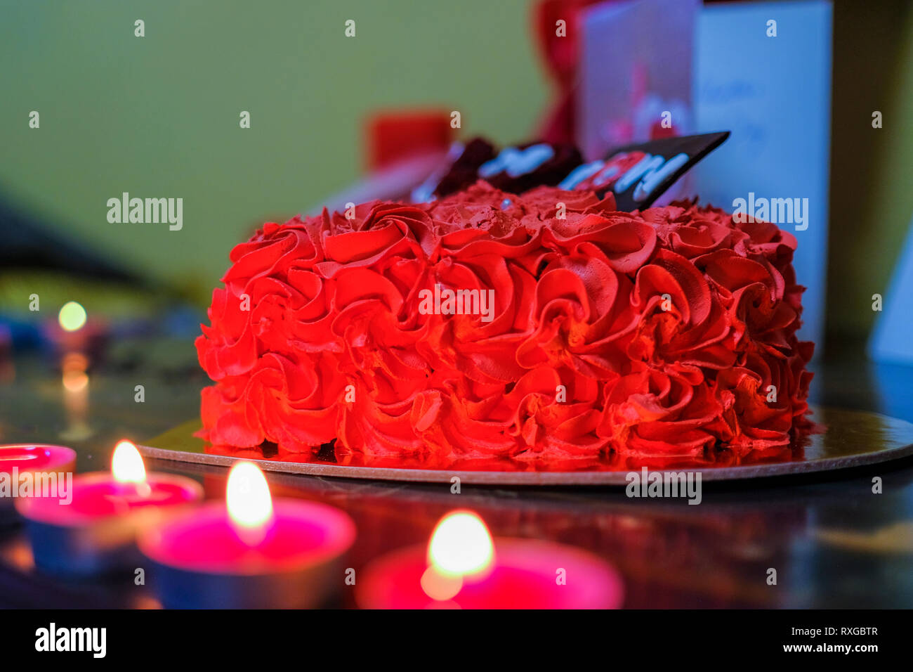 Red Cake With Blurred Candles
