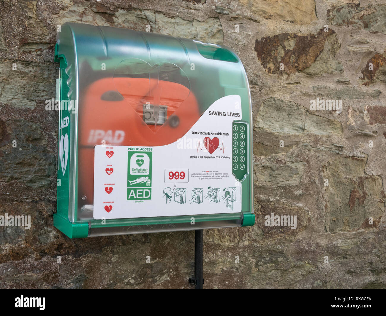 A Public Access Defibrillator / PAD fixed to an external wall. - Stock Image