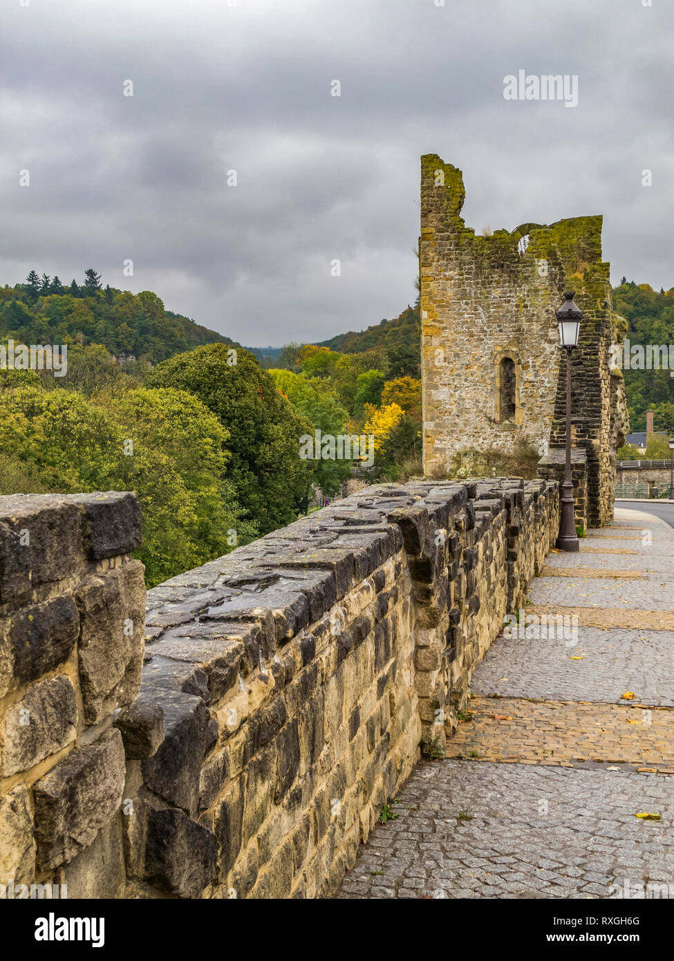 Hollow Tooth on the Bock rock- the remains of a tower of one of the fortress gates in Luxembourg City, Grand Duchy of Luxembourg on a rainy October da - Stock Image