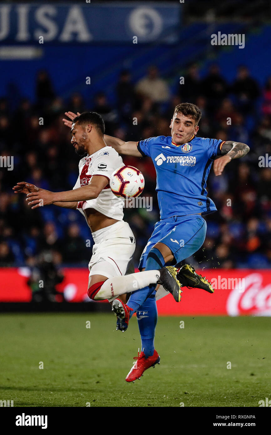 Getafe, Spain. 9th Mar, 2019. La Liga football, Getafe versus SD Huesca; Yangel Herrera (SD Huesca) challenges Mathias Olivera (Getafe CF) Credit: Action Plus Sports/Alamy Live News - Stock Image