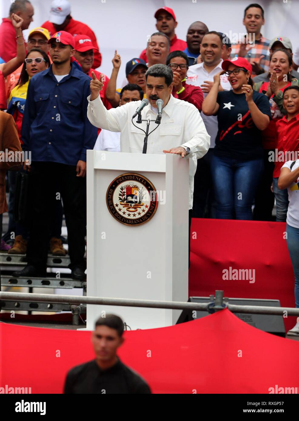 Caracas, Venezuela. 09th Mar, 2019. The President of Venezuela Nicolas Maduro (C) offers the closing speech of the march against imperialism and electric sabotage, in Caracas, Venezuela, 09 March 2019. Credit: Raul Martinez/EFE/Alamy Live News - Stock Image