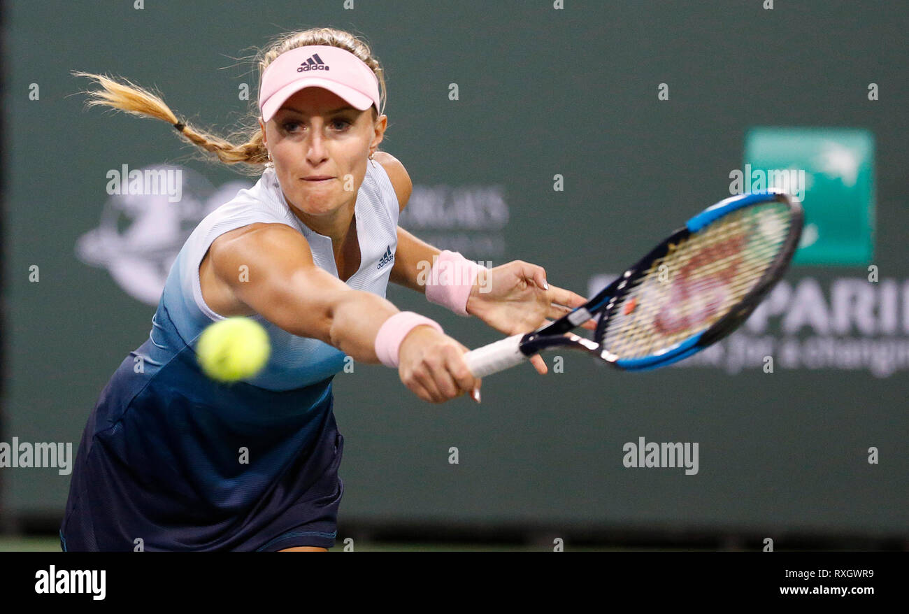 California, USA. 9th March 2019. 2019 Kristina Mladenovic (FRA) returns a shot against Naomi Osaka (JPN)during the 2019 BNP Paribas Open at Indian Wells Tennis Garden in Indian Wells, California. Charles Baus/CSM Credit: Cal Sport Media/Alamy Live News - Stock Image