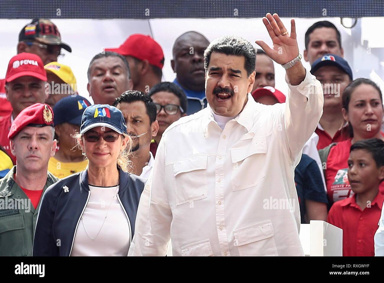 Caracas, Venezuela. 09th Mar, 2019. CARACAS, VENEZUELA - MARCH 10, 2019: Venezuela's President Nicolas Maduro (R) and his wife Cilia Flores during a rally marking Anti-imperialism Day. Valery Sharifulin/TASS Credit: ITAR-TASS News Agency/Alamy Live News - Stock Image