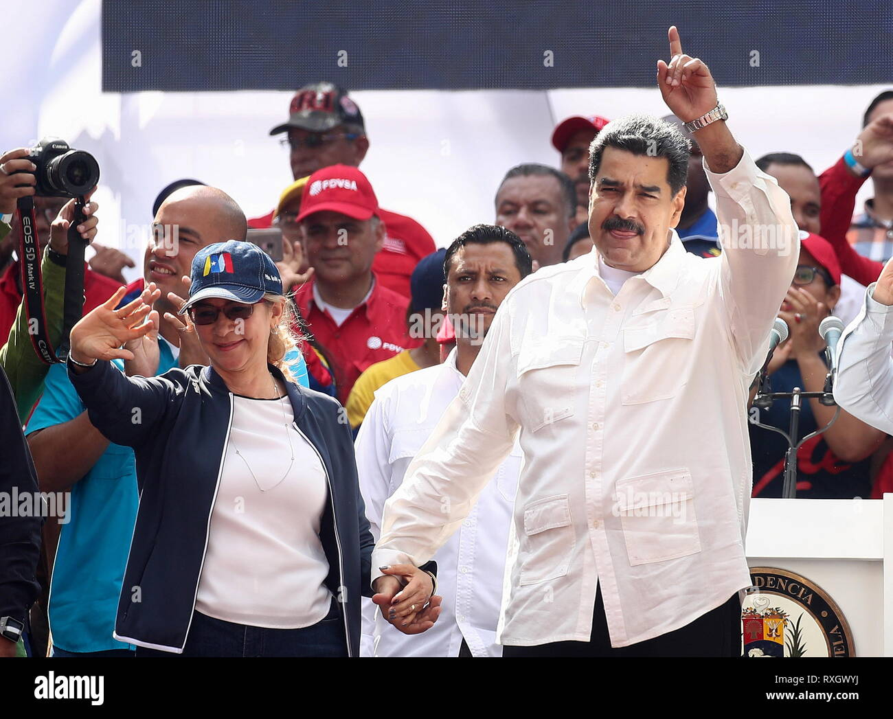 Caracas, Venezuela. 09th Mar, 2019. CARACAS, VENEZUELA - MARCH 10, 2019: Venezuela's President Nicolas Maduro (R) and his wife Cilia Flores during a rally marking Anti-imperialism Day by the Miraflores Palaca. Valery Sharifulin/TASS Credit: ITAR-TASS News Agency/Alamy Live News - Stock Image