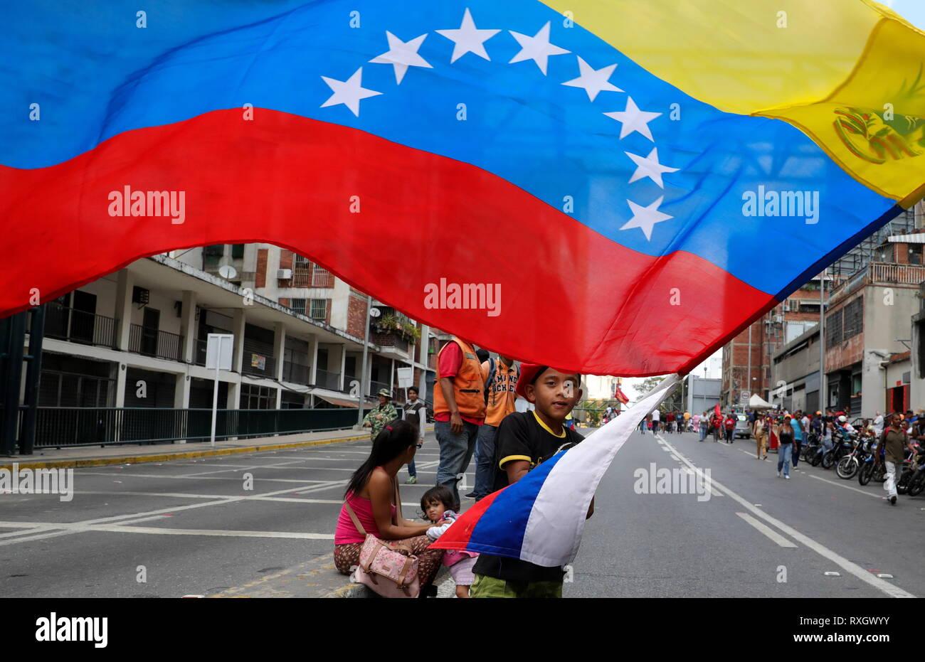 Caracas, Venezuela. 09th Mar, 2019. CARACAS, VENEZUELA - MARCH 10, 2019: Supporters of Venezuela's President Nicolas Maduro during a rally marking Anti-imperialism Day by the Miraflores Palaca. Valery Sharifulin/TASS Credit: ITAR-TASS News Agency/Alamy Live News - Stock Image