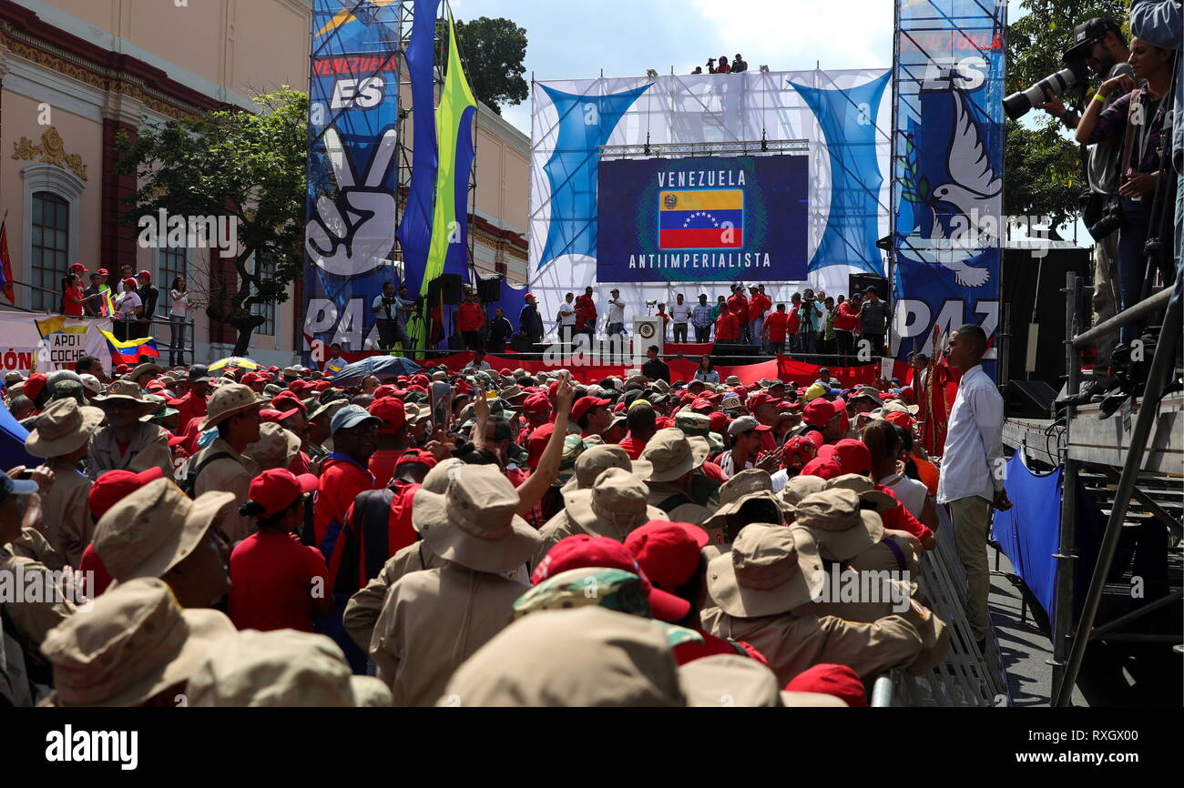 Caracas, Venezuela. 09th Mar, 2019. CARACAS, VENEZUELA - MARCH 10, 2019: Supporters of Venezuela's President Nicolas Maduro during a rally marking Anti-imperialism Day by the Miraflores Palaca. Valery Sharifulin/TASS Credit: ITAR-TASS News Agency/Alamy Live News - Stock Image