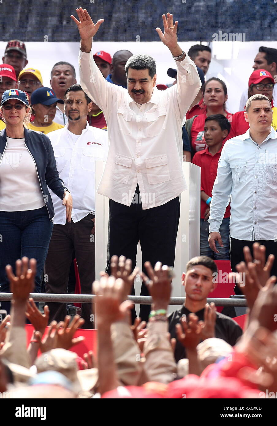 Caracas, Venezuela. 09th Mar, 2019. CARACAS, VENEZUELA - MARCH 10, 2019: Venezuela's President Nicolas Maduro (C) and his wife Cilia Flores (L) during a rally marking Anti-imperialism Day by the Miraflores Palace. Valery Sharifulin/TASS Credit: ITAR-TASS News Agency/Alamy Live News - Stock Image