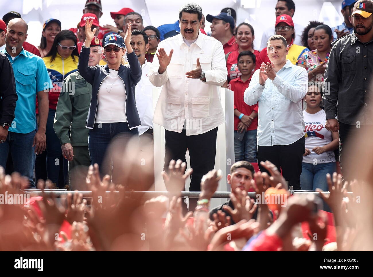 Caracas, Venezuela. 09th Mar, 2019. CARACAS, VENEZUELA - MARCH 10, 2019: Venezuela's President Nicolas Maduro (C) and his wife Cilia Flores (2nd R) during a rally marking Anti-imperialism Day by the Miraflores Palace. Valery Sharifulin/TASS Credit: ITAR-TASS News Agency/Alamy Live News - Stock Image
